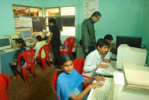 Helping hand: Visually impaired children at SRMAB learn how to use computers with the help of techies who volunteer on weekends.  Hemant Mishra / Mint