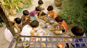 Busy bees: Many children wanted more than one diya to decorate. Ramesh Pathania / Mint
