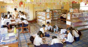 Engrossed: Students pore over library activities at a Room to Read project in Cambodia. Jayson Morris / Room to Read