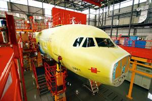 Going global: An Airbus SAS A320 airplane assembly line in Tianjin, China. EADS is the parent firm of the plane maker. Nelson Ching / Bloomberg