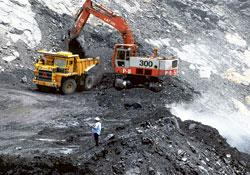 Ways of coping: A coal mine in Andhra Pradesh. India will not meet its projected demand of 730mt by 2012, unless 100mt of coal is imported. Noah Seelami / AFP