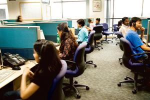 Campus bound: Employees at a Convergys call centre in Gurgaon. As employees are staying with their current employer, many outsourcing firms are turning more to campuses for fresh recruitment. Madhu Ka