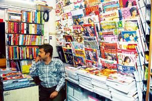 Feeling the pinch: A magazine stand in New Delhi. Magazines account for 13% of the Rs14,900 crore print advertising pie, says a report. Ramesh Pathania / Mint