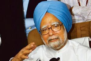 Holding ground: Manmohan Singh addresses the media on board his special aircraft while returning from Washington on Sunday. Subhash Chander Malhotra / PTI