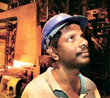 Demand meltdown: A file photo of a worker at an Ispat Industries? unit. The  firm? had? earlier  cut output by 35%. Graham Morrison / Bloomberg