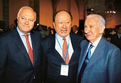 Spain's foreign minister Miguel Angel Moratinos, chairman of the China Federation of Industrial Economics Xu Kuangdi and former head of the International Olympic Committee Juan Antonio Samaranch at th
