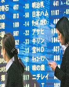 Crisis pinch:Women walk past an electronic stock board outside a securities firm in Tokyo on Thursday. Japanese shares slumped, sending the Nikkei below 8,000 for the first time in four weeks. Tomohir