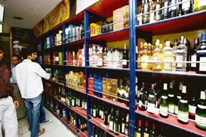 Watchful: In Delhi, the authorities have been demanding identity proof from those buying more than 4 litres of Indian made foreign liquor. Rajeev Dabral / Mint