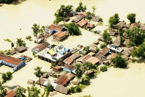 Force of nature: A flooded village in Madhubani, Bihar, in August last year. Scientists suspected global warming to be the cause of the floods. Deepak Kumar / AFP