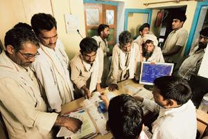 Back-up security: A file photo of farmers checking agricultural loans waiver lists at a State Bank of India branch in Uttar Pradesh. Consumers in rural India often use gold as collateral to access loa