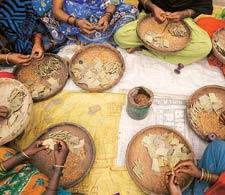 Job insecurity: Women labourers making beedis in West Bengal. The beedi industry warned last month that as many as one million workers, mostly women, are set to lose their jobs in the next few months.