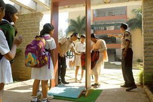 Safeguarding: Security personnel checking bags of schoolchildren at Delhi Public School, Bangalore (north). Hemant Mishra / Mint