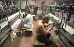 No relief: A file photo of workers at a textile mill in Mumbai. Santosh Verma / Bloomberg