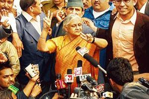Victory mode: Chief minister Sheila Dikshit with the media at her residence in New Delhi on Monday. Congress will form the government for the third time after it won 42 seats in the 29 November elect