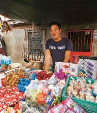 Scarce jobs: Sonny del Pilar, 33, set up at stall selling stuffed toys outside his home in Batasan Hills, Quezon City in the Philippines, after trying for eight years to get work as a sailor and join