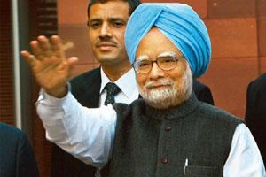 In charge: Prime Minister Manmohan Singh waves to the media at Parliament in New Delhi on Wednesday. Kamal Singh / PTI