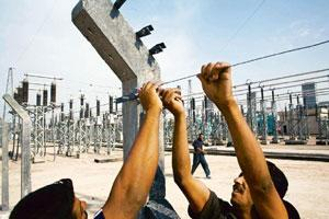 Piecemeal approach: Workers at a new generator in Baghdad, Iraq, in an October 2007 photo. Electricity output is now only slightly higher than it was before the US invaded the country. Michael Kamber
