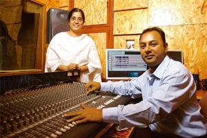 Tuning in: Charsur founders Charubala Natarajan (left) and Suresh Gopalan in their studio in Chennai. SHARP IMAGE