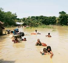 No relief: A file photo of flood-affected people in Bihar. Floods in Kosi displaced about 2.5 million people in India and Nepal this year. Rupak De Chowdhuri / Reuters
