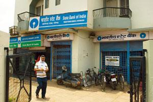 Vote of confidence: A State Bank of India branch in Uttar Pradesh. The bank saw deposits grow 28% in the July-September quarter over the same period in 2007. New deposits are reported to have soared