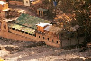 Raided: An abandoned Jamaat-ud-Dawa camp on the outskirts of Muzaffarabad on 13 December. In the wake of the Mumbai attacks, Pakistan has moved against both Lashkar-e-Taiba and Jamaat-ud-Dawa, althoug