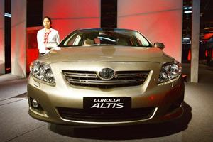 Cost pressure: The Corolla Altis at its New Delhi launch, The firms say they can no longer absorb the costs. Saurabh Das / AP