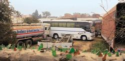 End of the road: Repossessed commercial vehicles parked at a farm in Nagli Dairy area of Najafgarh in Delhi. Mint