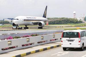 Better placed: A Singapore Airlines jet is towed to the runway at Changi Airport in Singapore. Experts say regional airlines should be able to weather the downturn better than their US and European pe