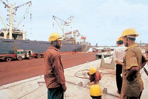 In deep trouble: Labourers at the Haldia port in West Bengal. India Today Image