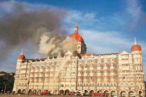 Preventive step: A file photo of firefighters trying to douse the fire at the Taj Mahal hotel in Mumbai. The government wants to pull down advertisements that could cause law and order problems.Punit