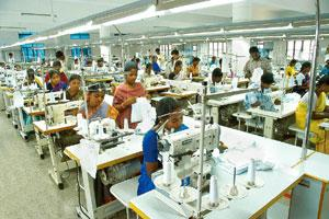 Double whammy: A garment stitching factory in Tirupur. The export hub has about 350,000 workers in some 6,000 units. The textile industry's troubles have been aggravated by a power crisis that has pu