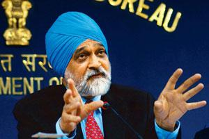 Right push: Montek Singh Ahluwalia, deputy chairman of the Planning Commission, has indicated that petrol and diesel prices may be reduced a second time within a month. They had last been cut on 6 De