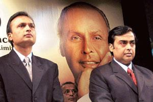 Together we stand? A file picture of Reliance Industries chairman Mukesh Ambani (right) and his younger brother Anil of Reliance-Anil Dhirubhai Ambani Group observing a two-minute silence in memory of