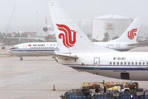 In a tailspin: Air China planes in Beijing. China's biggest overseas carrier expects to post its first annual loss in at least eight years. Doug Kanter / Bloomberg