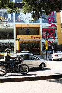 Busy street: The Odyssey store on 100-ft Road.