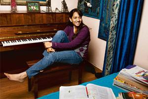 Study break: Vyushita Sahai, who's appearing for her class X board exams, relaxes by playing the piano. Madhu Kapparath / Mint