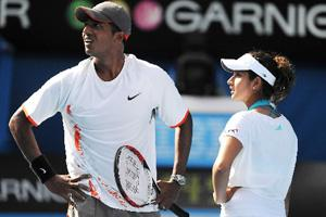 Mahesh Bhupathi (left) and Sania Mirza dispute a line call during their mixed doubles final match on day 14 of the Australian Open tennis tournament in Melbourne on 27 Jan 2008. Bloomberg