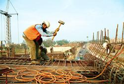 Slow work: A file photo of a construction site in New Delhi. Construction delays at five World Bank-funded highway stretches have put them behind schedule, prompting inquiries by the bank and NHAI. Qi