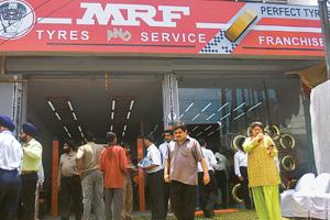 Cautious approach: An MRF franchise in New Delhi. The tyre maker hopes exports and replacement markets will counter the slowdown. S. Burmaula / HT