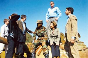 Pyrotechnical style: Holbrooke stands on a tank in Herat, Afghanistan, behind his wife, Kati Marton, in a 2006 family photo. His negotiating skills have won him an unusual title—representative rather