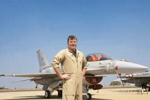 Tough task: Lockheed Martin Corp.'s F-16 test pilot Paul Randall in front of his aircraft. He says Bangalore's heat and the altitude make flying a very challenging task for the pilots at the air show.