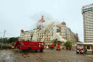 Stalling act? A 29 Nov picture of the Taj hotel. Pakistan was due to make public the preliminary findings of the investigation into the terrorist attack in Mumbai. But on Monday it issued a statement
