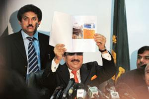 Step forward: Rehman Malik, Pakistan interior ministry chief speaks about the terror suspects at a press conference in Islamabad on 12 Feb. Aamir Qureshi / AFP