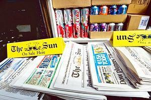 Cumulative effort: A copy of the final edition of The New York Sun on display at a news-stand on 30 September. The US newspaper industry, which is facing a decline in revenues from print editions, ne