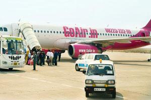 Plan early: Passengers boarding a GoAir aircraft. The low-fare carrier is offering zero-base fare tickets only for bookings made at least 30 days ahead of the travel date; as the date approaches, the