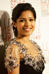Being gorgeous: Actor Freida Pinto in a Chanel dress with an embellished neckline. Joel Ryan / AP