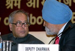 Finance minister Pranab Mukherjee and deputy chairman of Planning Commission Montek Singh Ahluwalia during the 42nd session of Indian Labour Conference in New Delhi on Friday. Kamal Singh / PTI