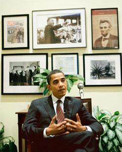 Wall of inspiration: Obama in his Senate office with photos of Gandhi and Martin Luther King Jr. Pablo Martinez Monsivais / AP