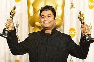 Two-in-one: A.R. Rahman holds up his Oscars for best original song and best original score for Slumdog Millionaire. Mike Blake / Reuters