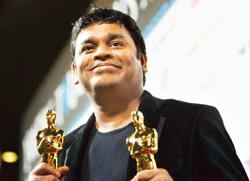 Triumphant note: Composer A.R. Rahman holds his Oscars for best original song Jai Ho and best music score for Slumdog Millionaire. Mario Anzuoni / Reuters